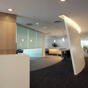 Reception area of office with cream desk and architecture, ceiling, daylighting, floor, flooring, glass, interior design, lobby, office, real estate, gray