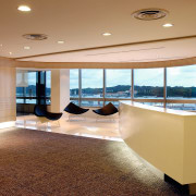 Reception area in office with curved walls, and ceiling, floor, flooring, interior design, lobby, real estate, orange, brown