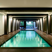 View of the indoor swimming pool - View interior design, lighting, lobby, property, real estate, swimming pool, brown
