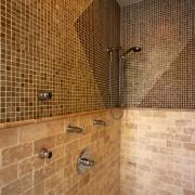 View of this shower with mosaic tiles - bathroom, floor, flooring, interior design, plumbing fixture, property, room, tile, wall, brown, orange