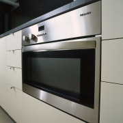clsoe up view of the oven - clsoe furniture, home appliance, kitchen, kitchen appliance, kitchen stove, major appliance, microwave oven, oven, product design, gray, black