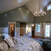 With its Gabled ceiling, white-painted wainscoting and traditional bedroom, ceiling, estate, home, interior design, living room, real estate, room, wall, window, gray, black