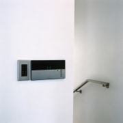 View of lighting system, white walls, steel stair electronics, product, product design, white, gray