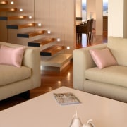 Lounge room with cream chairs and coffee table, floor, flooring, furniture, hardwood, interior design, living room, room, wood, wood flooring, orange, brown