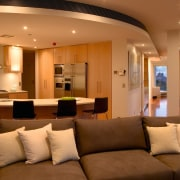 Open plan lounge and kitchen area with brown ceiling, interior design, lighting, living room, lobby, room, brown, orange