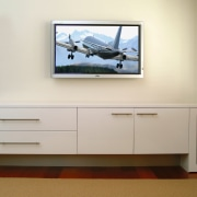 Interior view of lounge entertainment - Interior view chest of drawers, furniture, product design, shelving, sideboard, gray