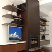 Interior view of shelving in lounge - Interior bookcase, cabinetry, fireplace, furniture, hearth, home appliance, interior design, living room, shelf, shelving, white, black