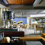 Restaurant area with patterned metal ceiling and column, interior design, restaurant, black