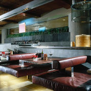 Red leather seats at tables, with restaurant kitchen interior design, lobby, restaurant, black, gray