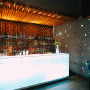 Restaurant bar with backlit polished glass, and timber architecture, interior design, lighting, wood, white