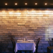 Restaurant table and chairs against feature wall of ceiling, daylighting, flooring, interior design, light, lighting, tile, wall, wood, black