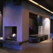 Seating area in bar with black leather ottoman fireplace, hearth, heat, interior design, lighting, black
