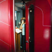 Large red doors with graphics, leading to radio door, interior design, light, lighting, red, room, red, black
