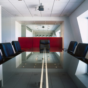 Boardroom table with lacquered centre stripe, upholstered chairs, conference hall, interior design, white, black