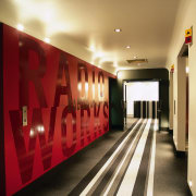 Lift lobby of Radio Works office, with red ceiling, flooring, interior design, lobby, brown