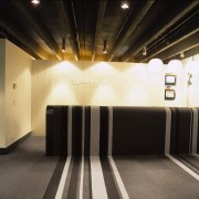 Striped black, white and grey carpet in reception ceiling, floor, flooring, interior design, light, lighting, lobby, black