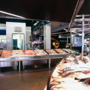 Closeup of fish in refrigerated display cabinet, with buffet, food, black