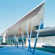 External view of convention centre, featuring zinc cladding architecture, building, commercial building, corporate headquarters, facade, headquarters, leisure centre, mixed use, real estate, sky, structure, teal