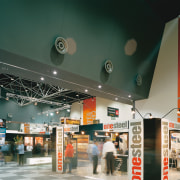 View of exhibition pavilion with various displays set glass, interior design, retail, gray