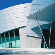 Exterior view of convention centre, showing zinc cladding architecture, building, commercial building, convention center, corporate headquarters, daylighting, daytime, facade, headquarters, landmark, line, reflection, sky, structure, tourist attraction, teal, white