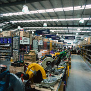 Interior of retail area showing power tools display, factory, industry, manufacturing, mass production, black, gray