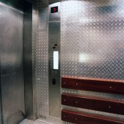 Service lift with heavy gauge aluminium chequer plate elevator, gray