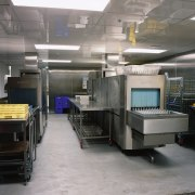 Commercial kitchen with stainless steel equipment and coolers. factory, machine, gray, black