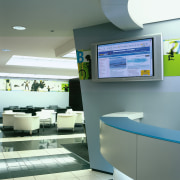 Philips Flat TV screen on wall above blue interior design, office, product design, gray, white