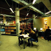 Interior view of library complex with muted colours institution, interior design, library, public library, brown, black