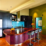 view of the kitchen showing maroon bench/eating area cabinetry, ceiling, countertop, floor, flooring, hardwood, interior design, kitchen, real estate, room, table, wood flooring, brown
