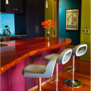 view of the kitchen showing polished timber flooring, chair, countertop, dining room, flooring, furniture, hardwood, interior design, room, table, wood, red