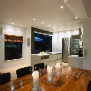 view of the dining area with kitchen in ceiling, interior design, living room, real estate, room, brown, gray