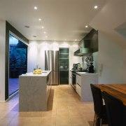 view of the kitchen area showing italian floor ceiling, countertop, floor, flooring, interior design, kitchen, real estate, room, gray
