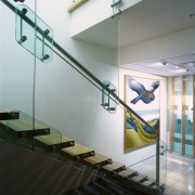 View of the wooden staircase with a glass daylighting, glass, handrail, interior design, stairs, gray