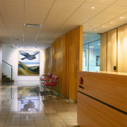 View of the reception area,a white wall with architecture, ceiling, floor, flooring, interior design, lobby, wood, brown