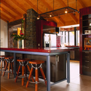 large vuew of the kitchen and informal eating ceiling, countertop, flooring, interior design, kitchen, table, wood, brown