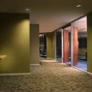 View of a hallway, bronze walls, cane walls, architecture, ceiling, floor, flooring, interior design, lobby, wall, brown