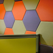 Close up of a wall made of many angle, floor, line, orange, red, wall, wood, yellow, brown