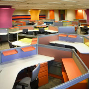 View of the hexagonal workstations, large pink collumns, furniture, interior design, office