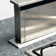 Kitchen extractor system rising out from benchtop behind furniture, product design, table, gray, white