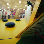 View of a seating area, book shelves beyond, bowling pin, floor, flooring, fun, indoor games and sports, interior design, leisure, leisure centre, room, sport venue, structure, yellow