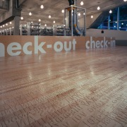 View of the check out area, large brown floor, flooring, hardwood, light, structure, wood, gray, brown