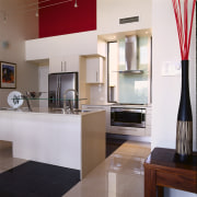 view of the kitchen area showing the stainless countertop, interior design, kitchen, real estate, room, white, gray