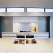 view of this clean pearl kitchen showing the countertop, interior design, kitchen, gray, white