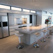view of this kitchen area showing timber flooring countertop, floor, interior design, kitchen, product design, gray