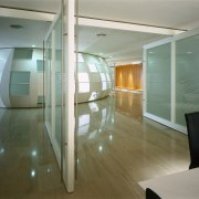 View of the entrance to the office, glimpse architecture, floor, glass, interior design, real estate, window, gray