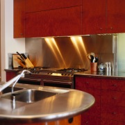 view of the stainless steel  benchtop and cabinetry, countertop, flooring, interior design, kitchen, room, under cabinet lighting, red, brown