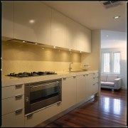 view of the modern kitchen area showing kitchen cabinetry, countertop, cuisine classique, interior design, kitchen, room, under cabinet lighting, brown