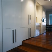 view of the polyurethane finished cabinetry and polished cabinetry, floor, flooring, glass, interior design, wall, gray