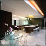 view of the kitchen and dining area showing architecture, ceiling, house, interior design, real estate, table, gray, black